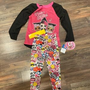 2 sets of pajamas with tags still on